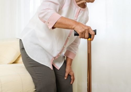 knee-pain-senior-woman-with-stick-healthcare-problem-senior-concept_61573-2602