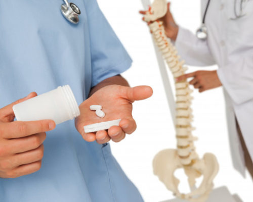 mid-section-doctors-with-pills-skeleton-model_13339-43488